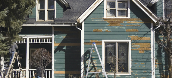 Exterior Scraped house before painting in minnesota